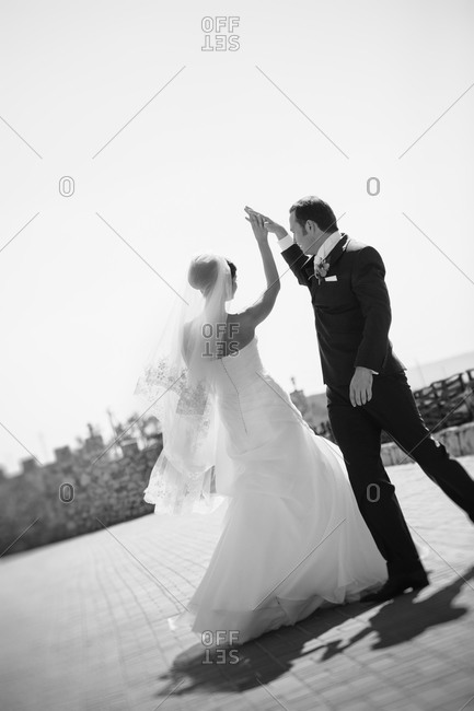 Newlyweds dancing outdoors