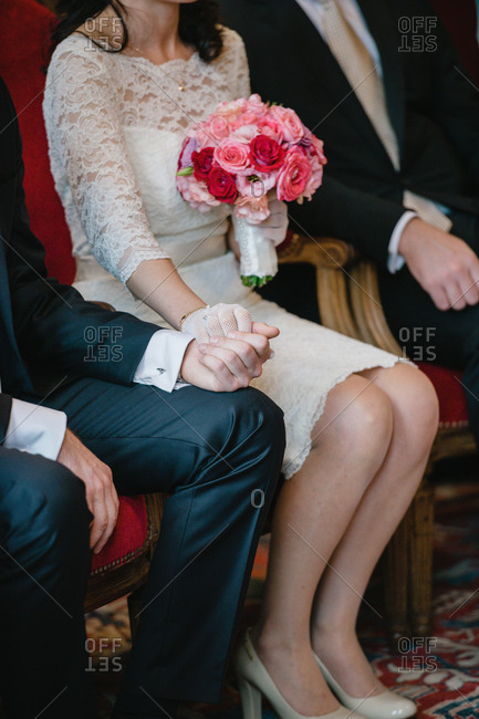 Couple holding hands during their civil wedding ceremony