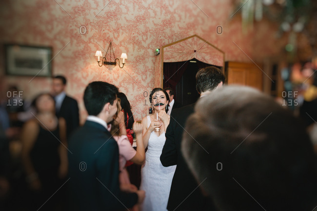 Bride joking with a fake mustache