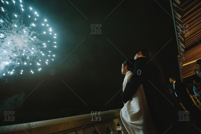 Newlyweds watching the fireworks together