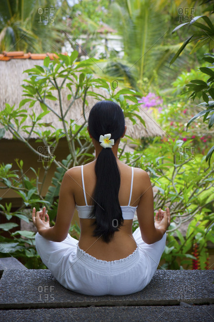 Woman doing yoga in tropics