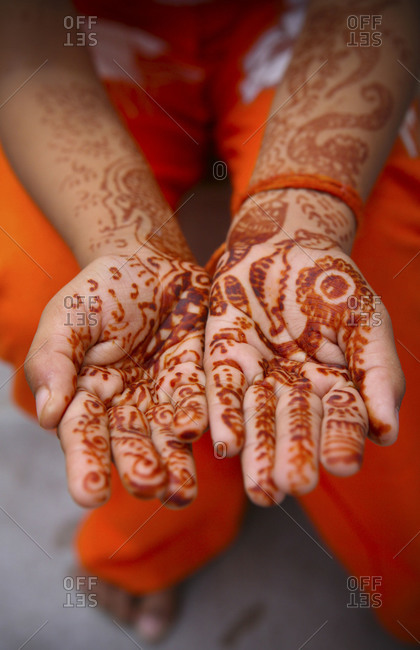 Woman showing henna on hands and arms