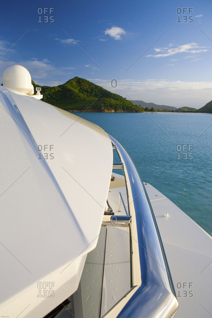 View towards green island over top of yacht