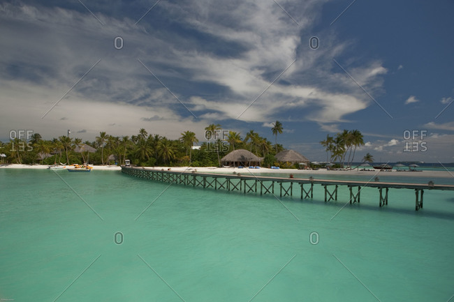 Dock and huts at tropical luxury resort