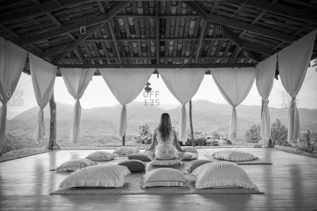 Black and white image of woman doing yoga