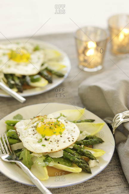 Eggs over a bed of healthy vegetables