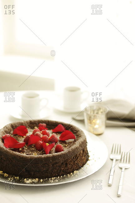 Flourless chocolate cake topped with fruit