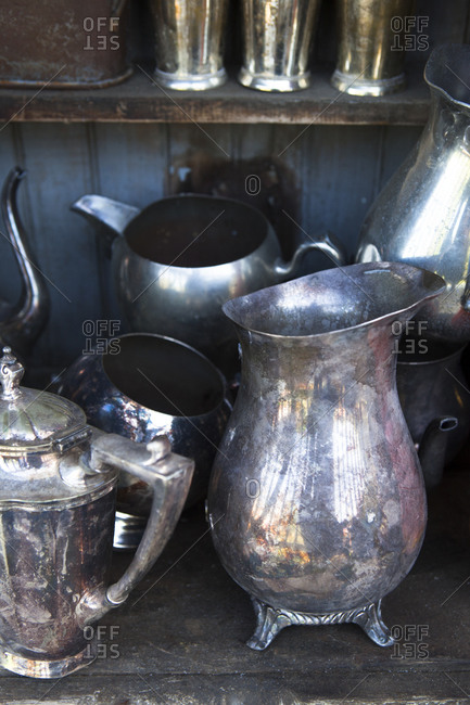 Pewter and silver vases