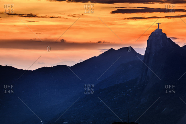 Christ the Redeemer, Corcovado Mountain, Rio de Janeiro, Brazil - March 4, 2013: Christ the Redeemer statue against sunset
