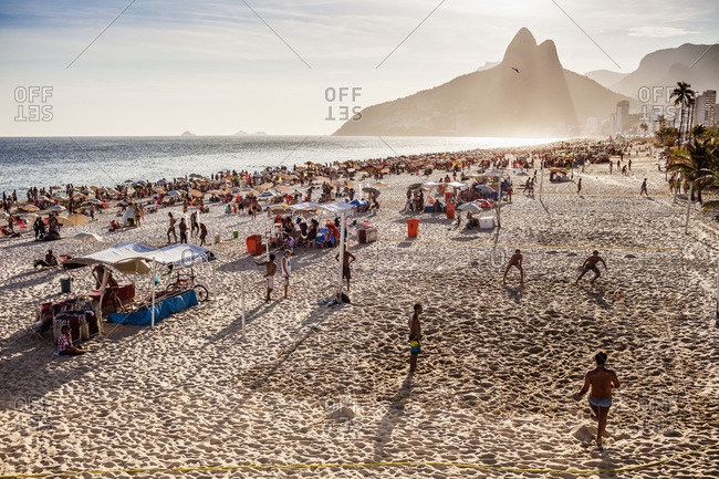 Ipanema beach, Rio de Janeiro, Brazil - February 14, 2013: People enjoying the sun and playing beach volleyball, Ipanema beach