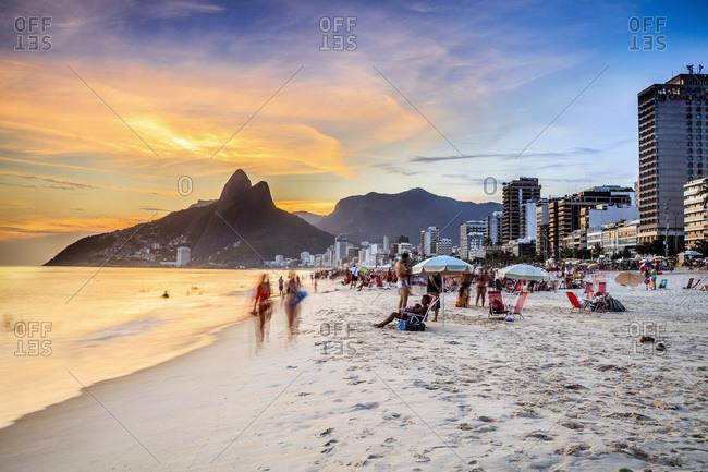 Ipanema beach, Rio de Janeiro, Brazil - February 14, 2013: People enjoying the beach, Ipanema beach