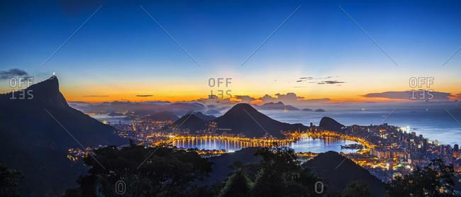 City at sunrise, Corcovado Mountain, Sugarloaf Mountain, Lagoa Rodrigo de Freitas and Ipanema Beach, view from Foresta da Tijuca