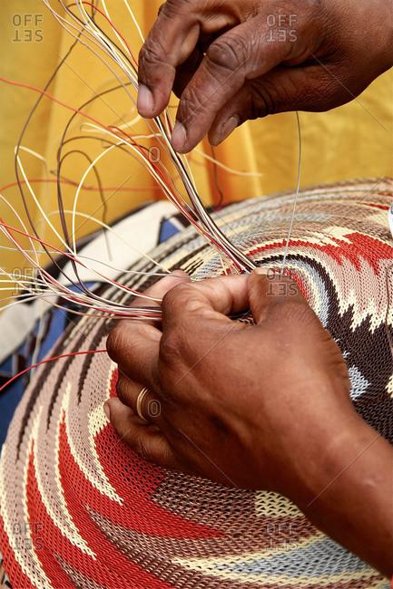 African woman demonstrating basket weaving at International Folk Art Market, Santa Fe, USA