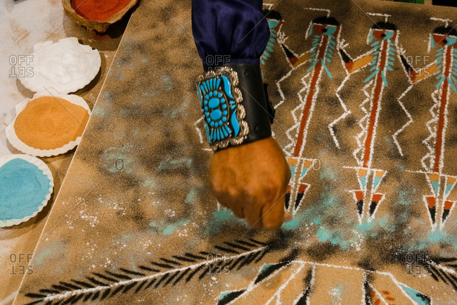 Navajo artist creating a sand painting in Santa Fe, New Mexico, United States