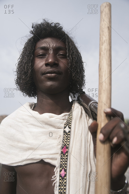 Danakil, Ethiopia - August 30, 2011: A traditionally dressed Afar man poses with a rifle