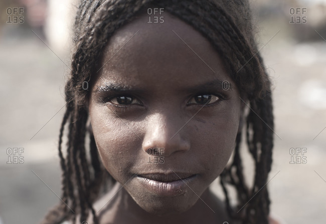 Asaita, Ethiopia - August 15, 2011: A young Afar girl with traditional hairstyle