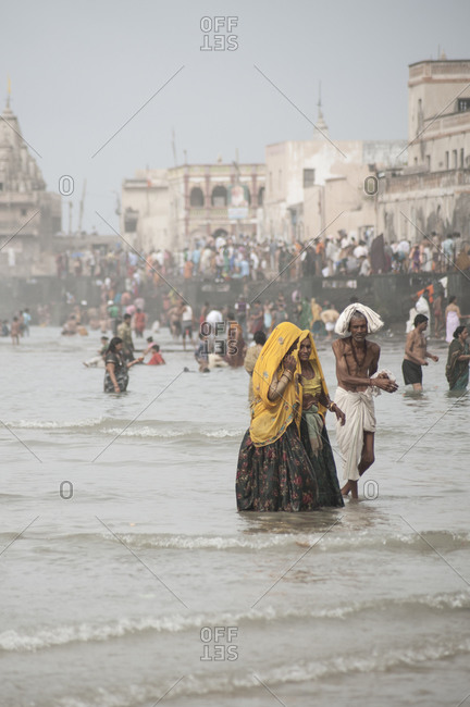 Dwarka, India - August 24, 2012: Pilgrims bathe at the ghats of Dwarka