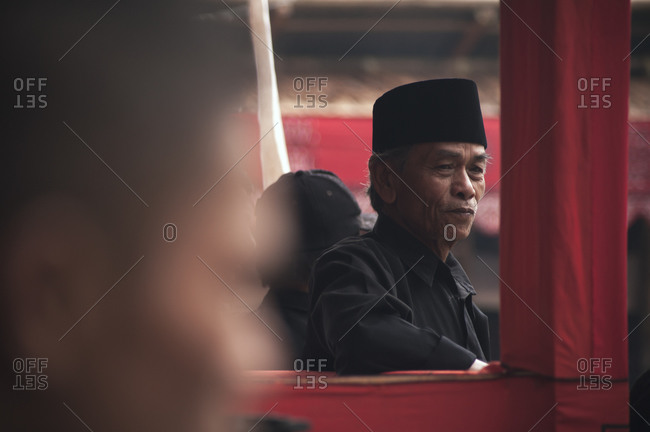 Tana Toraja, Indonesia - September 3, 2013: Man attending a Toraja funeral ceremony