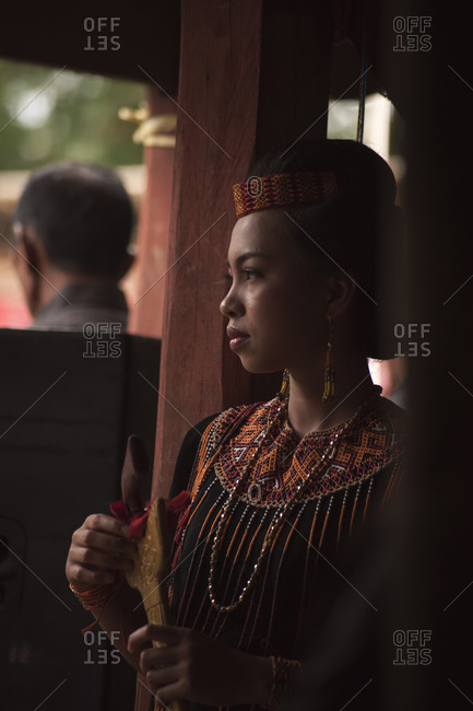 Tana Toraja, Indonesia - September 3, 2013: Young woman at funeral ceremony