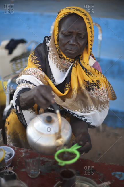Wadi Halfa, Sudan - September 26, 2011: A Nubian woman pours tea