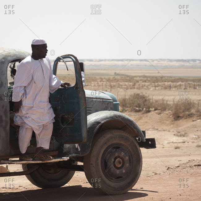 Wadi Halfa, Sudan - September 27, 2011: A Nubian man steeping out of a truck