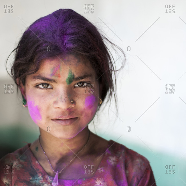 Himachal Pradesh, India - March 9, 2009: A young girl celebrated Holi