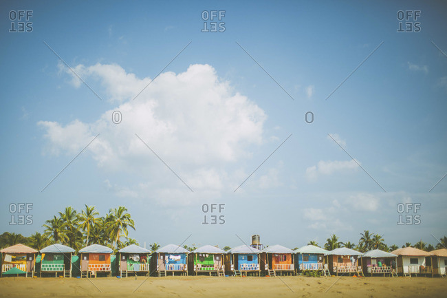 Colorful huts on beach in Goa, India