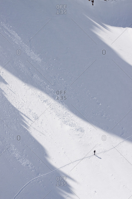 A backcountry skier under the Jesus Christ Couloir on Thompson Peak in the Sawtooth Mountains near Stanley, Idaho