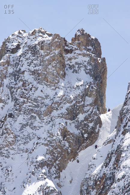 Backcountry skiers climbing the Jesus Christ Couloir on Thompson Peak in the Sawtooth Mountains near Stanley, Idaho
