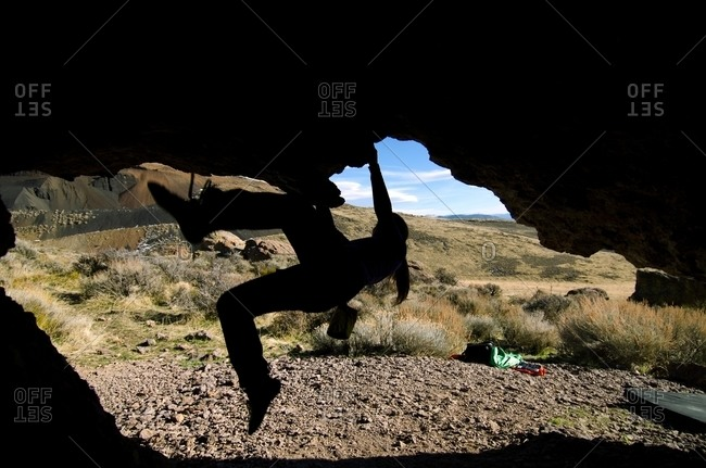 A silhouette of a woman bouldering in Washoe Valley, Nevada