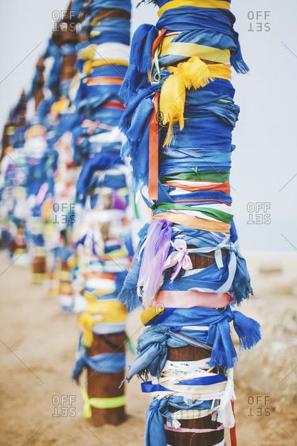 Buryat traditional pagan holy poles by the Lake Baikal, Siberia, Russia