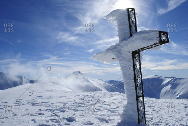 Frozen cross on a mountain top of Monti Sibillini National Park, Apennines, Italy