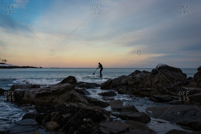 Man stand up paddle surfing in Kittery, Maine