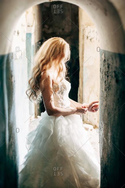 Bride adjusting the corsage on her wrist