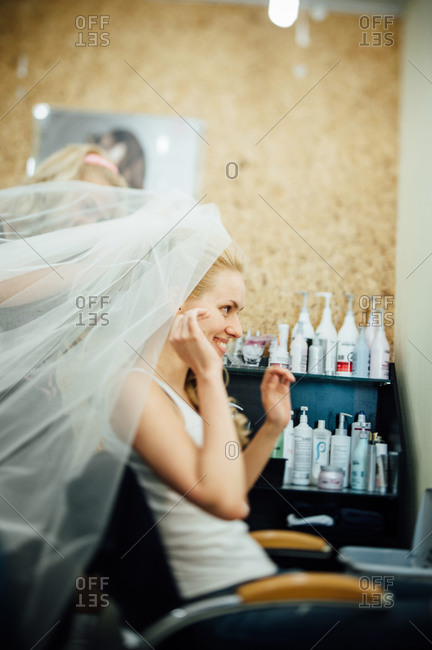 Bride trying on her veil in a hair salon