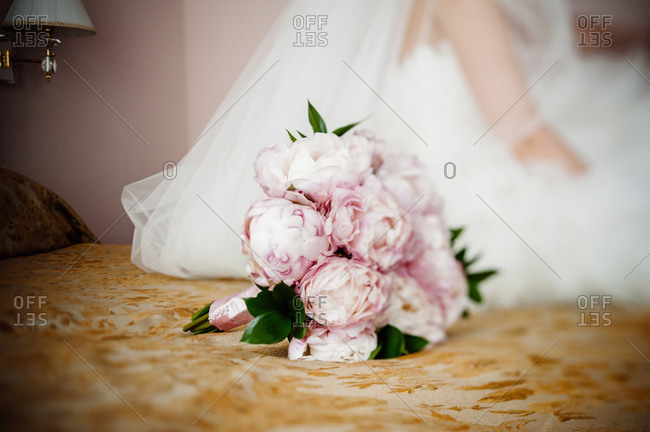 Wedding bouquet on a bed