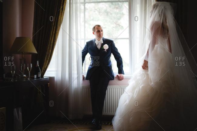 Newlywed couple posing inside a hotel room