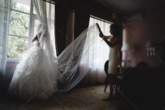 Bridesmaid holding the veil