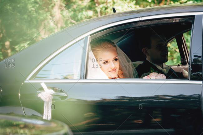 Newlyweds inside of a car