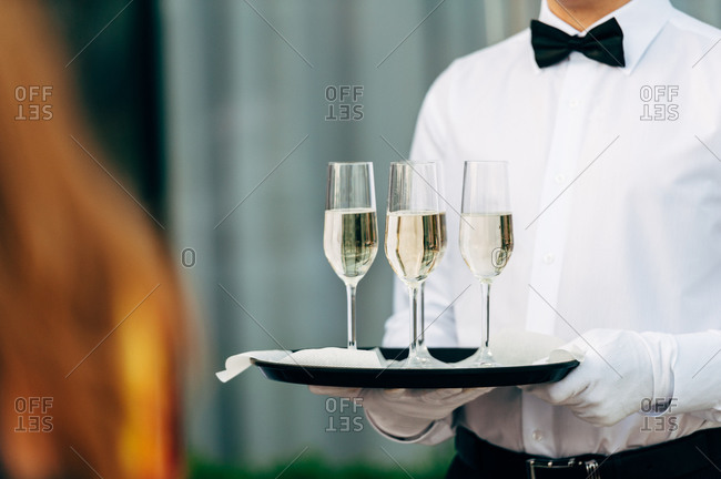 Waiter serving champagne at a wedding reception
