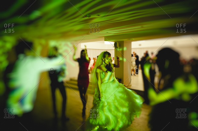 Newlywed wife dancing at the wedding reception