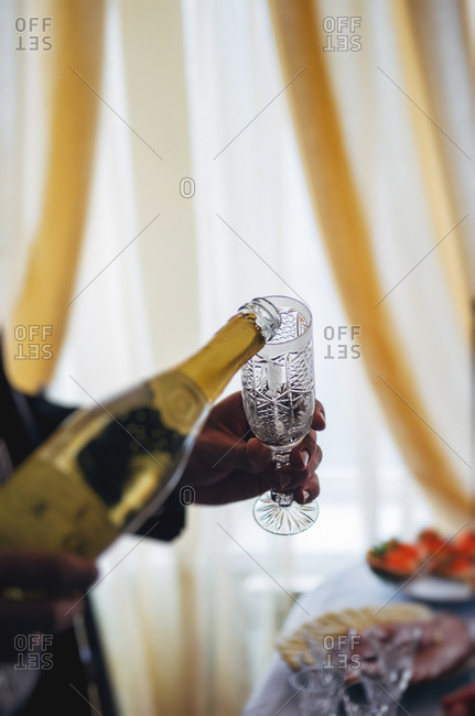 Pouring champagne at a wedding ceremony
