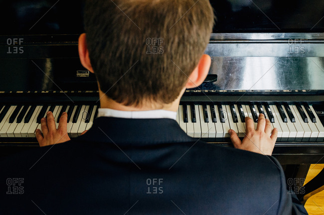 Overhead view of pianist playing music at wedding reception