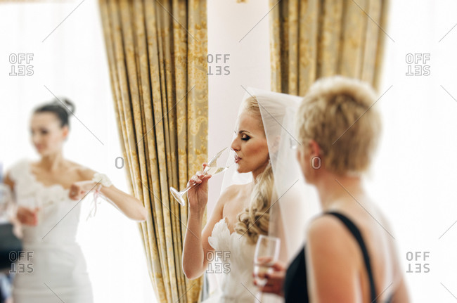 Drinking champagne at a wedding ceremony