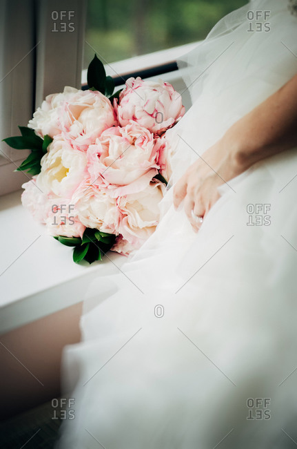 Close up of bride with her bridal bouquet