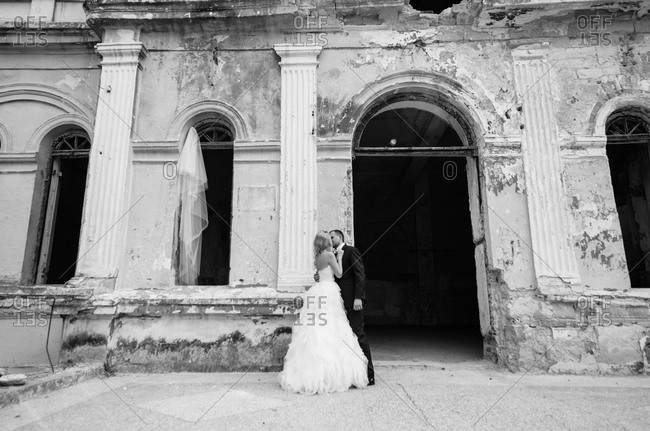 Newlyweds outside an abandoned building