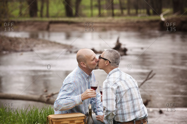 Same-sex couple kissing each other
