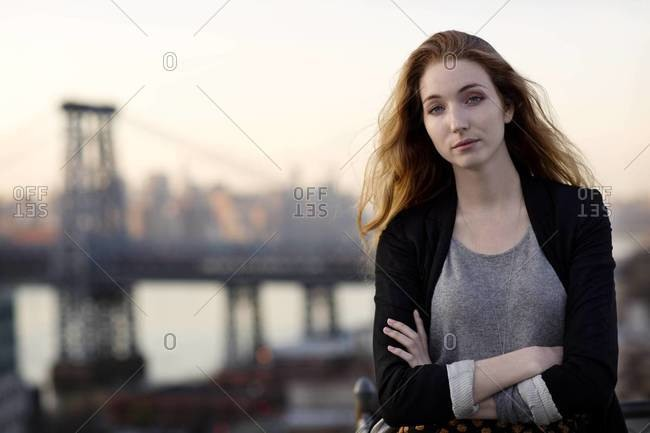 Young woman on roof, Williamsburg, Brooklyn
