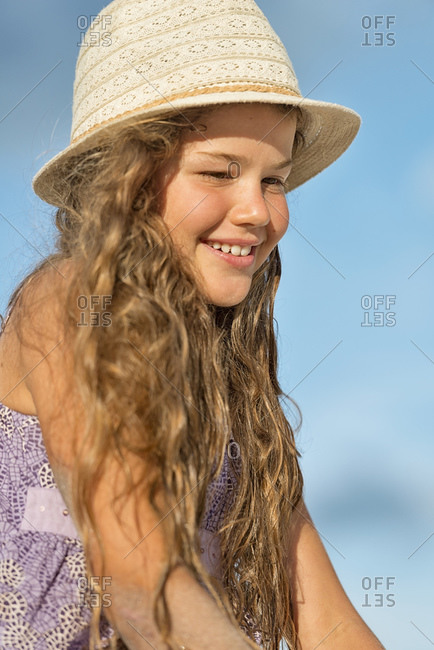 Smiling girl wearing summer hat