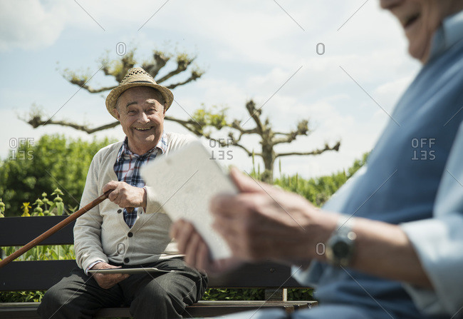 Two old friends enjoying using a tablet